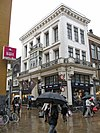 foto van Kledingwinkel in classicistische bouwstijl (F.I.J)