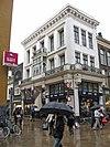 Kledingwinkel in classicistische bouwstijl (F.I.J)