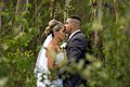 Groom gives bride forehead kiss (Unsplash).jpg