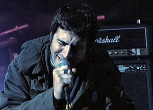 Gruff Rhys - Rhys on stage with the band Mogwai in Scotland, 2001