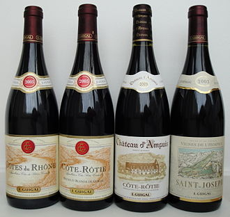 Guigal - Four bottles of Guigal wine showing the different label designs. The two bottles on the left carry the standard Guigal label and the two bottles on the right are high-end wines with individual label designs.