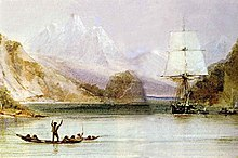 On a sea inlet surrounded by steep hills, with high snow-covered mountains in the distance, someone standing in an open canoe waves at a square-rigged sailing ship, seen from the front