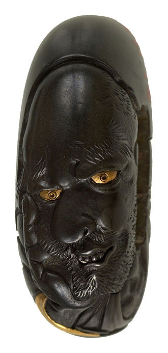Shibuichi - Kashira made of dark-finished shibuichi, with gold highlights