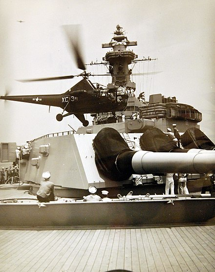 A helicopter lands on a Missouri gun turret during 1948 Midshipmen's Practice Cruise Helicopter lands on USS Missouri (BB-63) gun turret, 1948 Midshipmen's Practice Cruise (37781879662).jpg