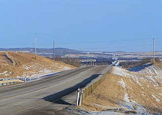 Red Deer County - Highway 11 passing through ranch land and aspen parkland in the west of the county
