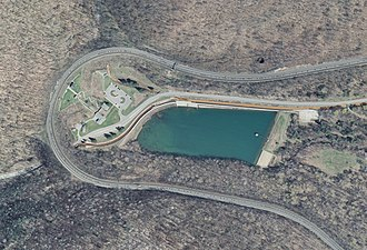 Horseshoe Curve (Pennsylvania) - Orthophoto of the Horseshoe Curve. Trains headed counterclockwise around the curve are ascending. The visitor center and observation park are at the apex of the curve, and a reservoir is located in the valley spanned by it.