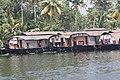 House Boats Are Parked At A Jetty in Vembanattu Lake,Kumarakom,Alleppy,Kerala,India - panoramio.jpg