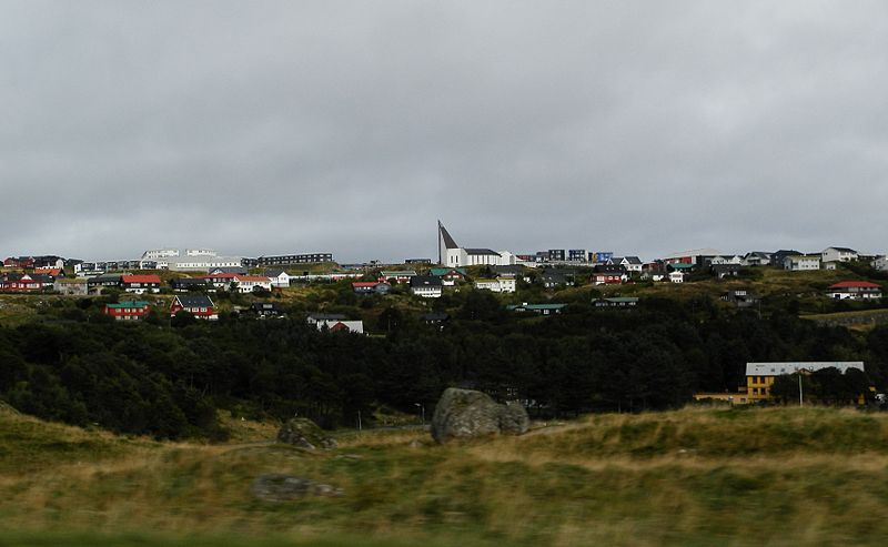 The upper part of Hoyvík and a part of Hoydalar in the foreground. The Church of Hoyvík is in the centre of the photo.