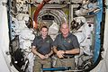 ISS-48 Kate Rubins and Jeff Williams with their spacesuits inside the Quest airlock.jpg