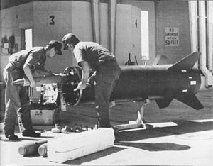 Operation Igloo White - Air Force ordnancemen load a dispenser with seismic sensors