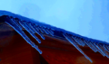 Icicles off Wooden Roof (11533900573).png