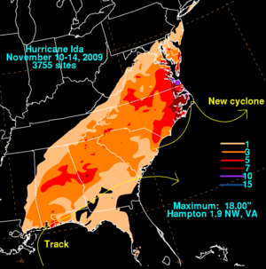 Map of the eastern United States depicting rainfall from a tropical cyclone. Accumulations are depicted by colored regions and areas without rain are left black.