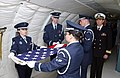 Inside the cargo compartment of a National Aeronautics and Space Administration (NASA) C-135A Stratolifter aircraft, a US Air Force (USAF) Honor Guard folds the American Flag, after - DPLA - c5495686ae8845b174be73e8e3d37896.jpeg