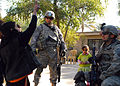 Iraqi children look up to Multi-National Division-Baghdad Soldiers during MND-B Commanding General's visit to Taji DVIDS145031.jpg