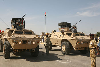 English: Iraqi army soldiers drive light armor...