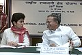 Jaipal Reddy in conversation with the Minister of State for Urban Employment & Poverty Alleviation, Kumari Selja at the meeting of the National Capital Region Planning Board, in New Delhi on May 24, 2006.jpg