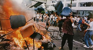 Fall of Suharto - Shops looted and goods burned on the streets in Jakarta, 14 May 1998.