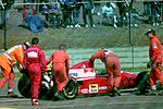 Jean Alesi - Ferrari F93A watches as his car is pushed away by marshalls during practice for the 1993 British Grand Prix (33530336732).jpg
