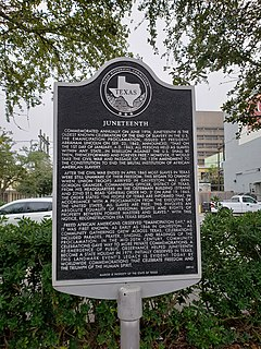 Commemorative plaque at intersection of Strand Street and 22nd Street in Galveston, Texas.