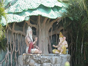 National epic - Modern depiction of Vyasa narrating the Mahabharata to Ganesha at the Murudeshwara temple, Karnataka.