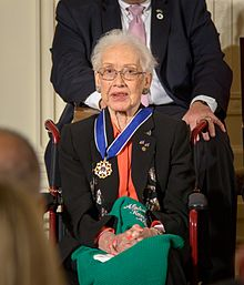 Johnson seated wearing her Presidential Medal of Freedom