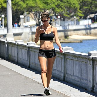 Sportswear (activewear) - A woman wearing sports bra and boyshorts, which were conventionally women's sportswear but are now also worn as casuals or athleisure by women in the West.