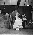"Leading Aircraftwoman Esther Bashford of the Women's Royal Air Force dances to the tune of ""When the Blue of the Night meets the Gold of the Day"" during a midnight cabaret put on at RAF Uxbridge during 1944. D22225.jpg"