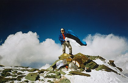 Setting up a flag could also possess the meaning of conquering something. Jaan Kunnap with the flag of Estonia at the top of Lenin Peak (7,134 m [23,406 feet]) in 1989. Lenini maetipp (J. Kunnap).jpg