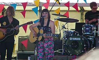 Lisa Mitchell - Mitchell at Big Day Out, Claremont, January 2010. On guitar is Stuart Barlow