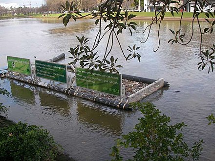 A Parks Victoria litter trap on the river to catch floating rubbish on the Yarra River at Birrarung Marr in Melbourne, Australia. Litter trap.jpg