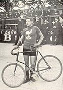 A picture of Louis Darragon beside his bike.