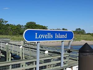 Lovells Island - Lovells Island sign on the dock.