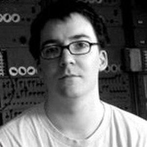 R. Luke DuBois - R. Luke DuBois in front of the RCA Mark II Synthesizer, 2006.