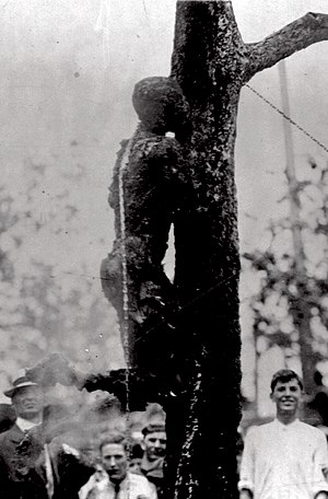 Lynching in the United States - Lynching of Jesse Washington in Waco, Texas, on May 15, 1916. He was repeatedly lowered and raised onto a fire for about two hours. A professional photographer took pictures of the lynching as it unfolded.