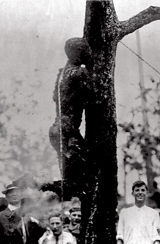 Lynching of Jesse Washington - Washington hanging from a tree after being severely burned