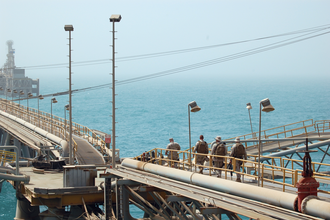 U.S. Navy and Coast Guard personnel stand guard aboard the Al Basrah Oil Terminal in July 2009. MESFABOT.png