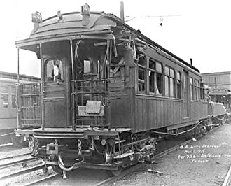 Malbone Street Wreck - The Malbone wreck train sits in the 36th-38th Street Yard after salvage. Lead car 726 (in front) bore relatively light damage. Nearly demolished car 100 is behind it.