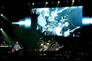 The Shadows - The Shadows in 2009 at the MEN Arena, Manchester, from left to right: (Warren Bennett), Bruce Welch, (Mark Griffiths), Brian Bennett and Hank Marvin