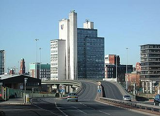 University of Manchester Institute of Science and Technology - UMIST's Mathematics and Social Sciences building seen from the Mancunian Way with original UMIST logo