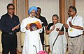 """Manmohan Singh releasing the book titled """"Monuments of Delhi"""", published by Archaeological Survey of India, (MO Culture), in New Delhi. The Chief Minister of Delhi, Sheila Dikshit and the Secretary, Ministry of Culture.jpg"""