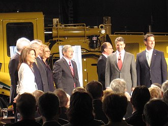 2012 Republican Party presidential debates and forums - Candidates and moderators gather on the stage of the Republican Presidential Forum On Manufacturing