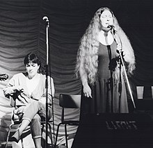 Mary Black sits while Dolores Keane sings with De Dannan at the 1985 Trowbridge Folk Festival