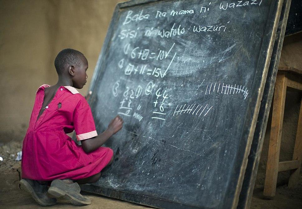 Masai girl at school doing maths