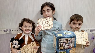 Matzo - Kids eating commercially made matzo.