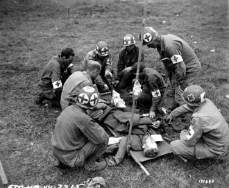 Combat medic - Medical team at work during the Battle of Normandy.
