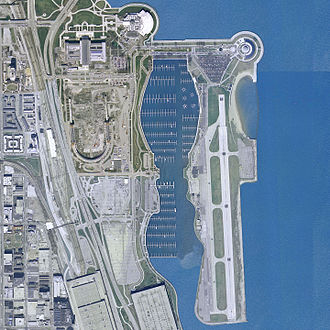 Soldier Field - Aerial view from 2002, showing Soldier Field with interior demolished. Meigs Field airport is to the right in the image.