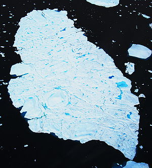 Melting iceberg photographed from a Bell 212 h...