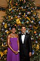 Michelle and Barack Obama pose in front of the official White House Christmas Tree.jpg