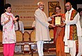 Mohd. Hamid Ansari presenting the Sangeet Natak Akademi Award-2010 to Shri M. V. Simhachala Sastry, Andhra Pradesh, for his outstanding contribution to Harikatha.jpg
