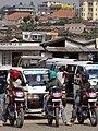 Moto-Drivers at Taxi Stand with Urban Backdrop - Muhanga-Gitarama - Rwanda.jpg